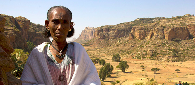 Shefina Kahsay, surrounded by the rocky terrain of her home in Northern Tigray, Ethiopia