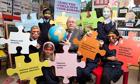 Minister Costello with pupils from George's Hill National School, Dublin at the launch of the Our World Irish Aid Awards 2013.