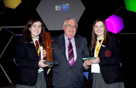 Minister for Trade and Development Joe Costello presents the Irish Aid special 'Science for Development' award to two Ballyclare High School students from Antrim at the BT Young Scientist and Technology Exhibition.