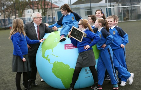 Minister Costello with students from Gaelscoil Bharra in Cabra at the launch of Our World Irish Aid Awards.