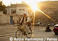 Afghanistan Man on bicycle. Photo: Robin Hammond / Panos