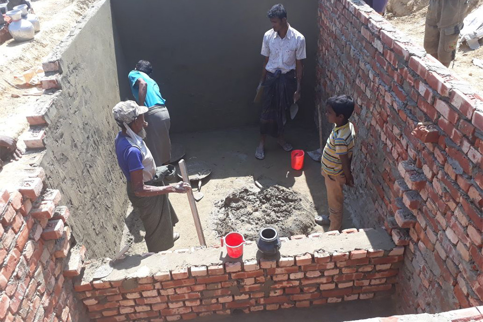 Contractors constructing Toilet Septic tanks for treating human waste